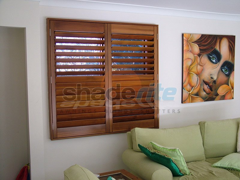 blinds shutters loungeroom interior open shutter plantation window aluminium bay